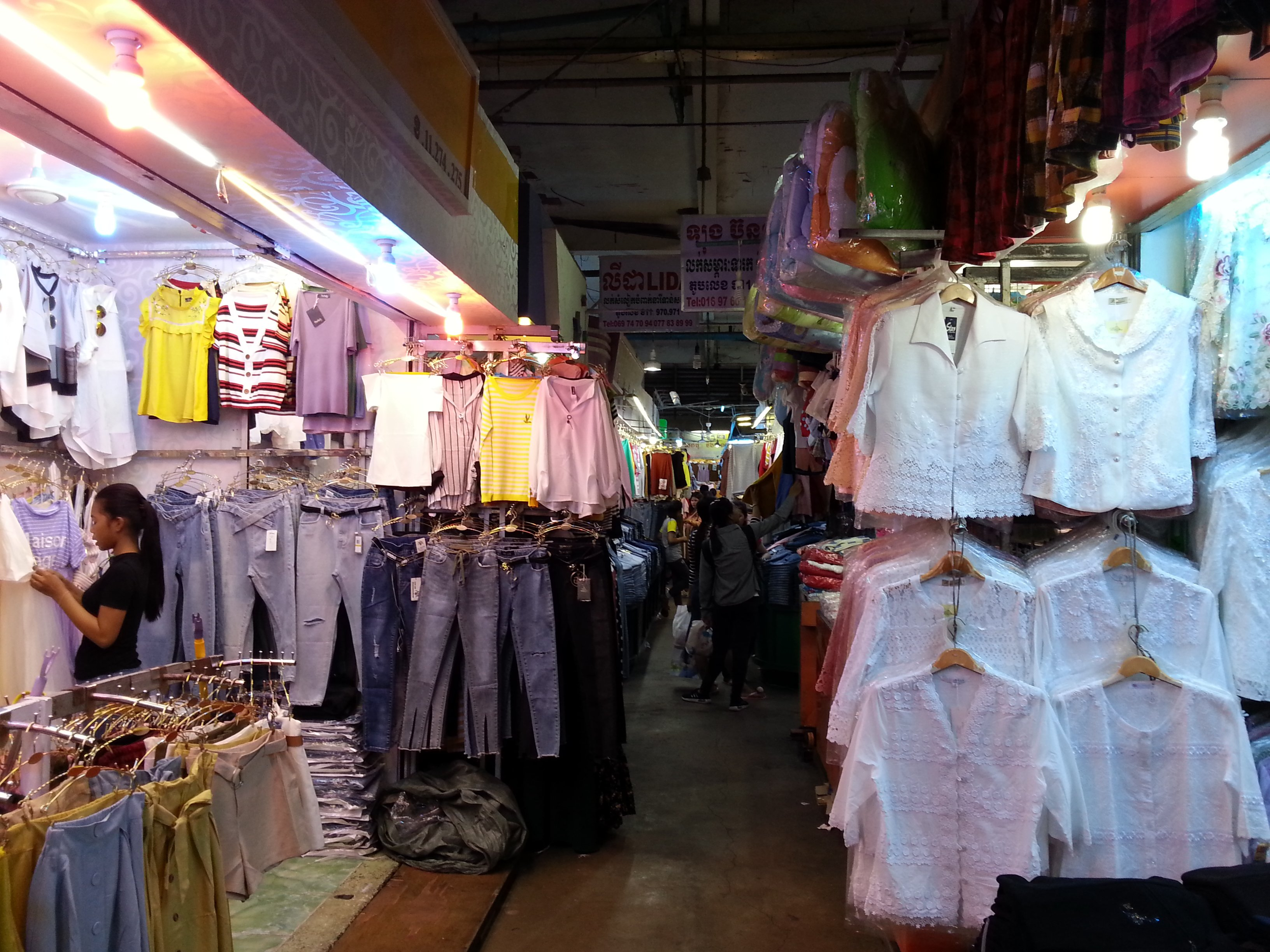Cambodian people come to Orussey Market to buy clothes