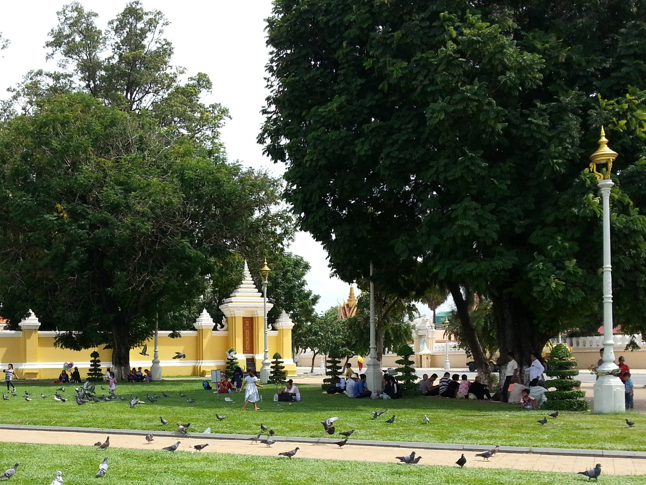 Local families enjoying a picnic in the Royal Palace Park