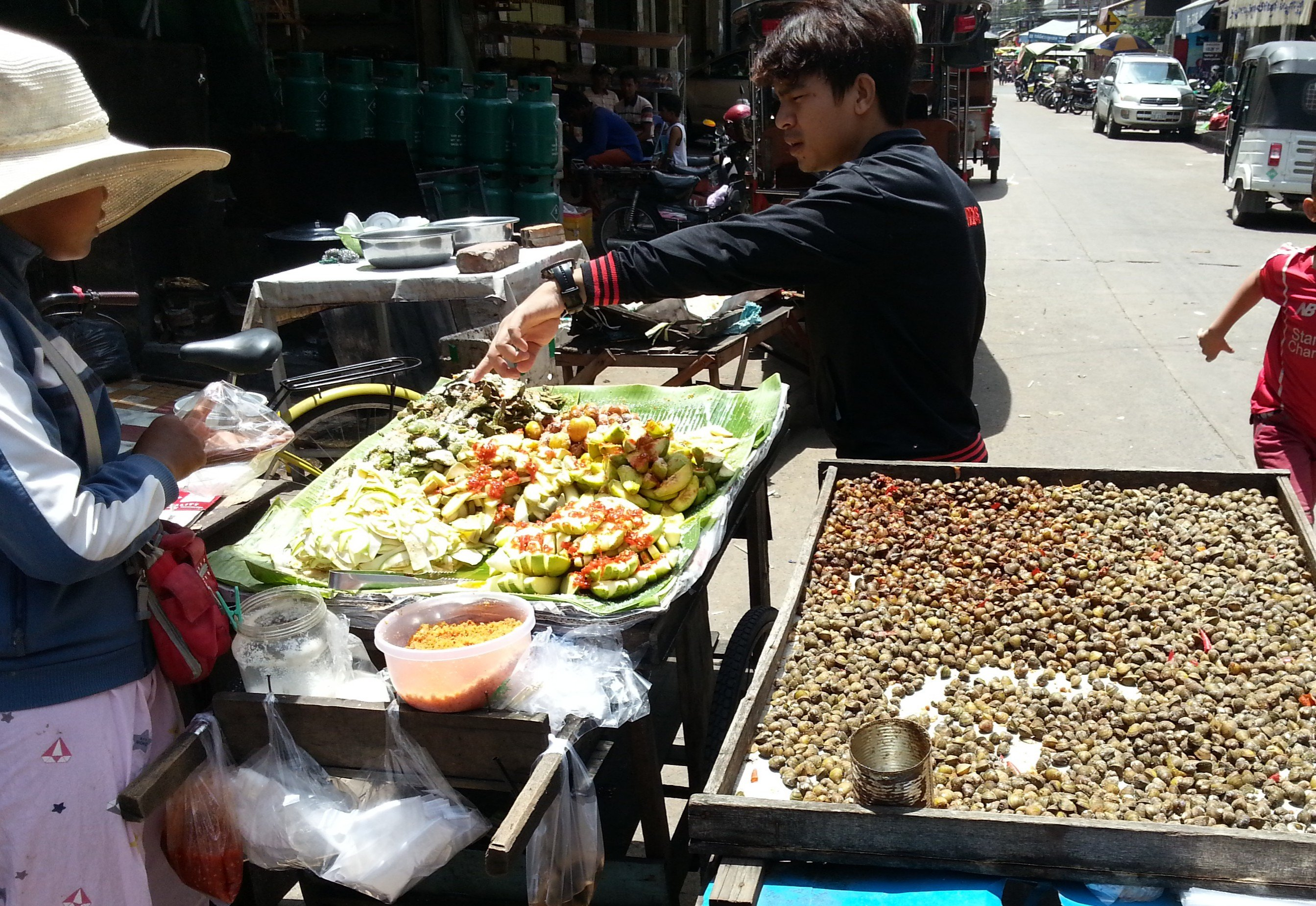 Pickled fruit and boiled water snails stall