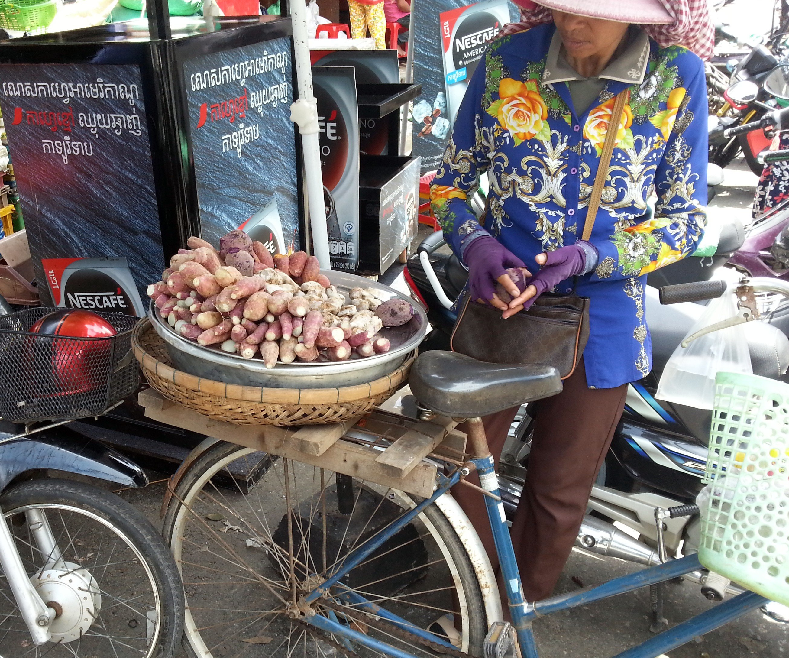 Steamed sweet potatoes sold from the back of a bike